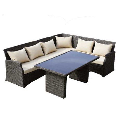 Salotto da esterno composto da lungo divano e tavolo con piano in vetro